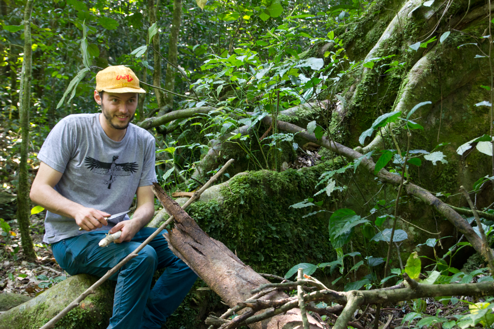 "alt=""a conservation student wearing my wildlife t-shirt design in the jungle"""