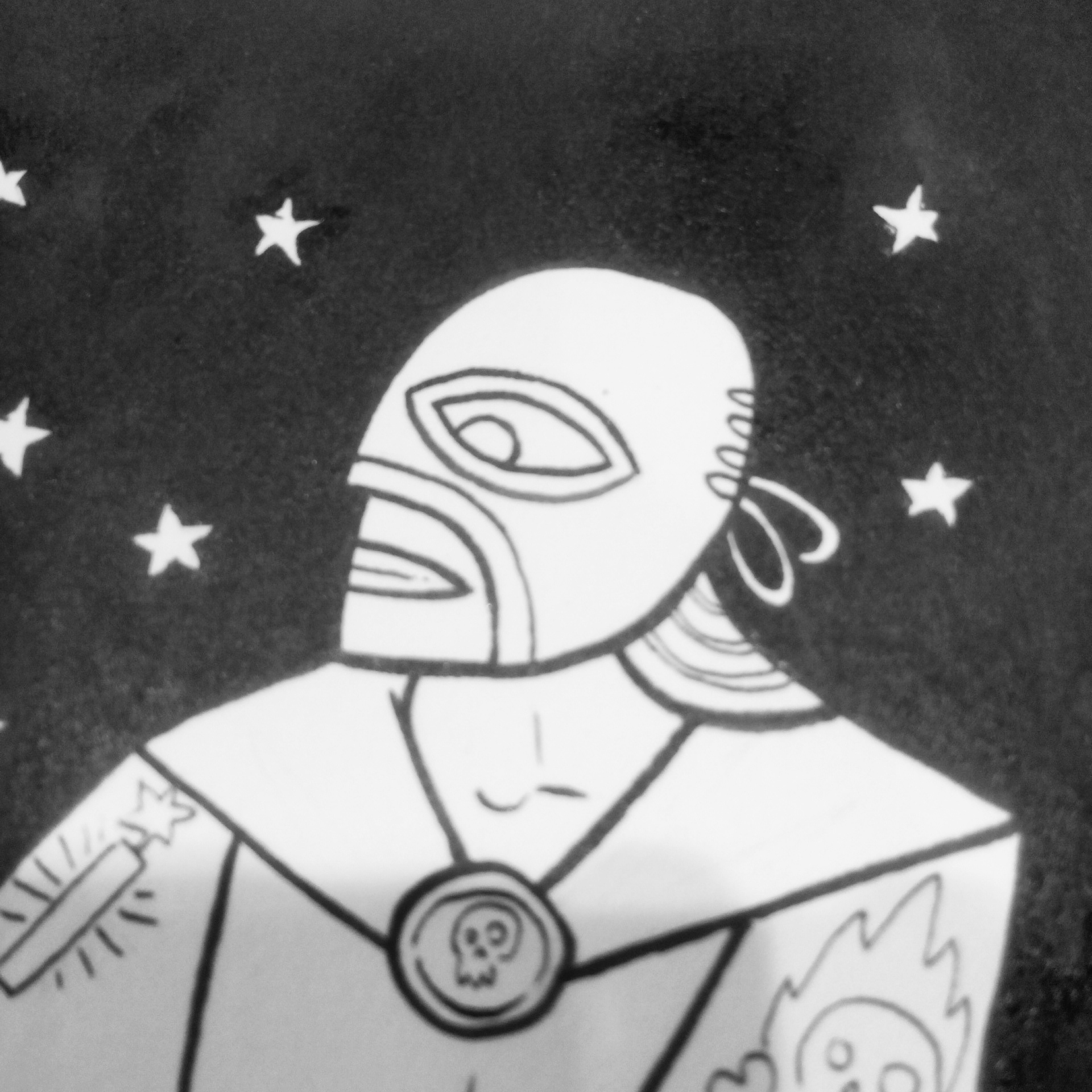 black and white photo of an ink drawing of a mexican wrestler